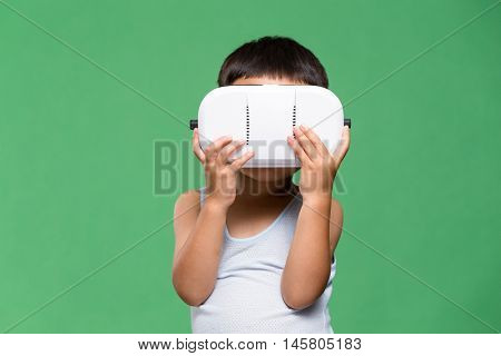 Young kid looking though VR device