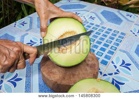 Melon On The Table Or Cantaloupe Salad. Slices Of Melon On A Table