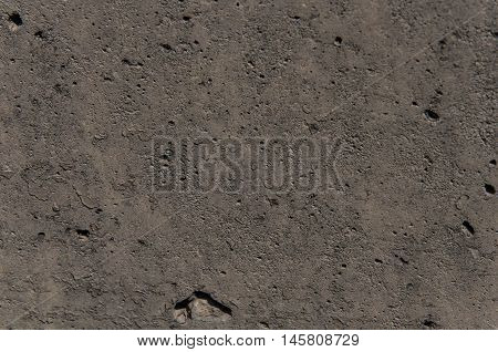 background of a gray concrete covering various testura of an uneven surface