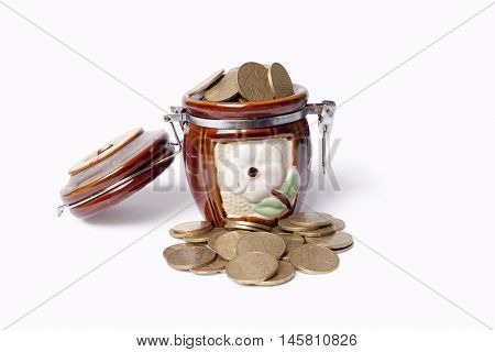 onyx pot with coins on white background