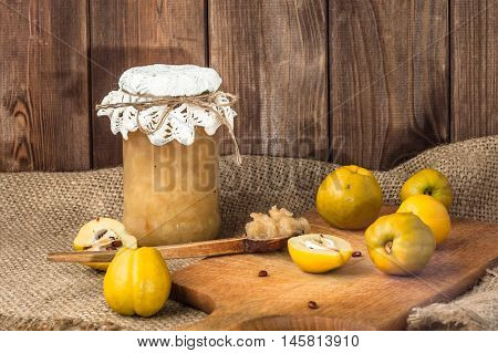 Quince jam in a wooden pantry. Autumn preserves made from fresh fruits