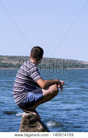 The Young Man Relaxing On The Beach