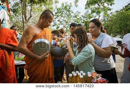 Prachuapkhirikhan Thailand - November 16 2015 : Unidentified people of Buddhist offer a foods to monks for make merit in a Religious ceremony,filtered image