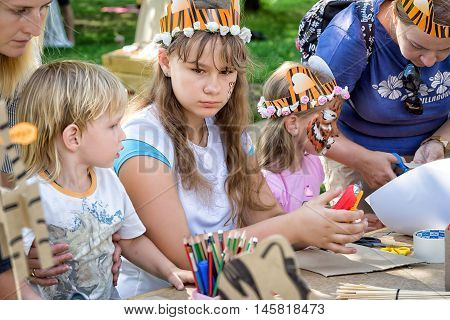 Moscow, Russia - July 31, 2016: Children In Tiger Costumes Draw And Create Crafts During The Celebra