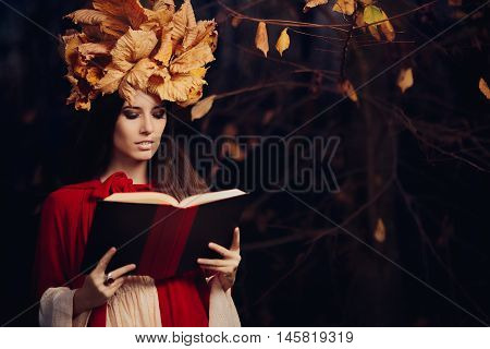Woman With Autumn Leaves Crown Reading a Book