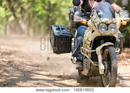 Motorcycle in forest on the road, color image