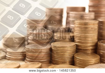 pile coin money with button calculator finance and banking concept for background.