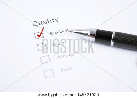 pen and survey form consumer with questionnaire checkbox for example for service quality.