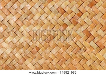 Traditional thai style pattern nature background of brown handicraft weave texture wicker surface for furniture materia