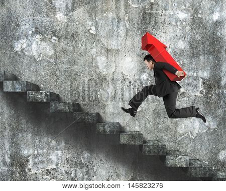 Businessman Carrying Red Arrow Sign Running On Stairs