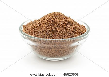 Organic powder of Indian Jujube (Ziziphus mauritiana) in a glass bowl. Isolated on white background. Front view.