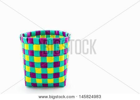 Color plastic basket on white background for home decorationHand craft work.