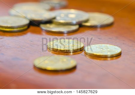Malaysian ringgit coins on old wooden desk