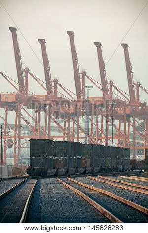 SEATTLE, WA - AUG 14: Crane Tower and cargo train at sea port on August 14, 2015 in Seattle. Seattle is the largest city in the State of Washington and the Pacific Northwest region of North America