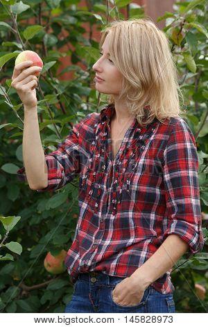 Woman Inspecting An Apple