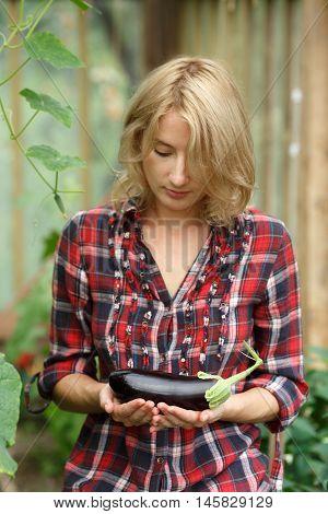 Woman Holding An Aubergine