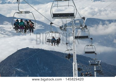 CHAMROUSSE, FRANCE - JANUARY 27, 2015: Skiers enjoying their winter vacation on the French ski resort Chamrousse