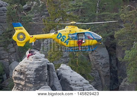 PRACHOV, CZECH REPUBLIC - MAY 21, 2016: Rescue helicopter coming to Prachov Rocks nature area to rescue the injured.