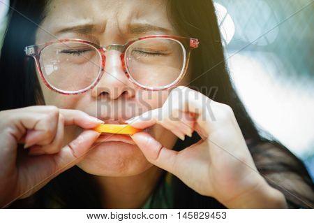 Portrait Closeup Woman Feel Sour With Orange