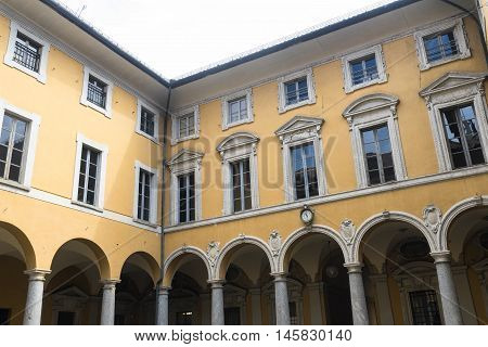 COMO, ITALY - JUNE 27, 2016: Como (Lombardy Italy): court of the historic palace Cernelli town hall built in the 16th century.