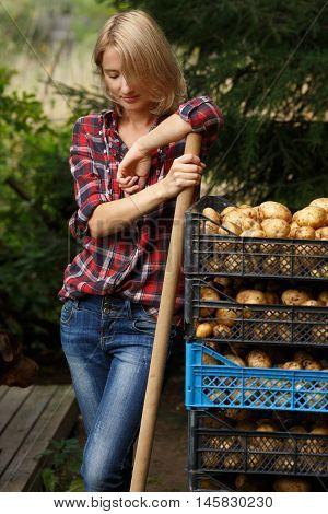 Woman Leaning On Potato Boxes