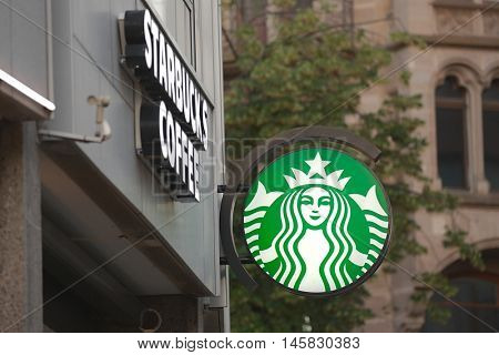 BASEL, SWITZERLAND - JULY 06, 2016: Starbucks coffee bar store front. Starbucks is an AMerican coffeehouse chain operating at more than 23000 locations worldwide.