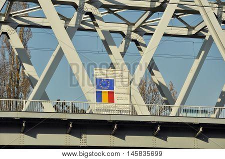 BUCHAREST ROMANIA - NOV 28 2008: European Fund information wall for the Bucharest Constanta railway repair from EU funds seen on a railway bridge