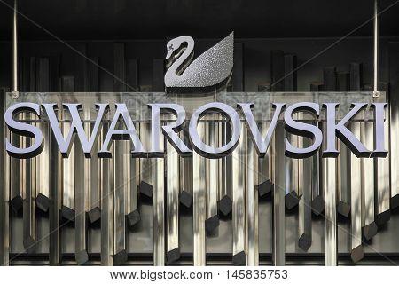 Lyon, France - August 15, 2016:  Swarovski logo on a wall. Swarovski is an Austrian producer of luxury cut lead glass, headquartered in Wattens, Austria