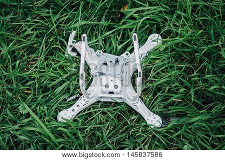 Crashed quadcopter after an accident laying on the ground