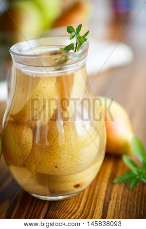 sweet pear compote in a decanter on a wooden table