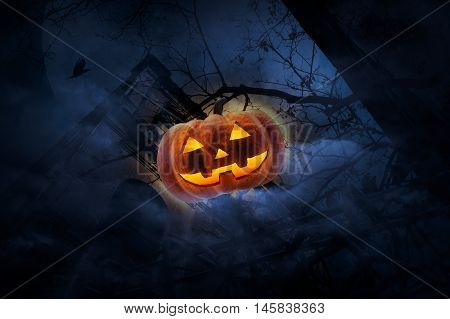 Jack O Lantern pumpkin over old fence grunge castle dead tree bird fly moon and cloudy sky Spooky background Halloween concept