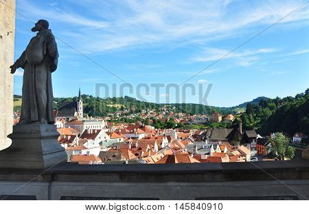Cesky Krumlov, Czech republic - July 9, 2015: View of Cesky Krumlov with a statue of some saint man in left