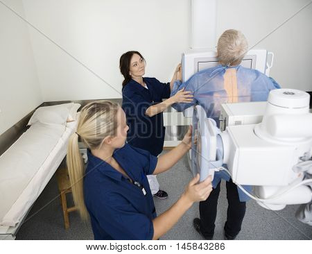 Radiologists Taking Xray Of Male Patient In Hospital