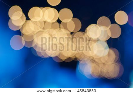 Christmas shiny glitter light abstract bokeh in golden colors, seasonal holiday blurred background