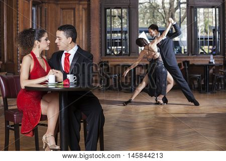 Couple Looking At Each Other While Tango Partners Performing