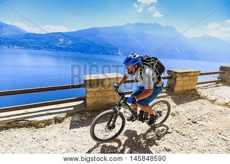 Mountain biking on Lake Garda, Sentiero della Ponale, Riva del Garda, Italy.