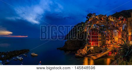 Amazing night view in Riomaggiore one of the five villages of the Cinque Terre on Italy mediterranean coast.