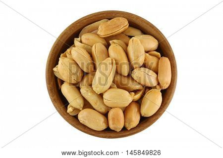 Top view of roasted salted peanut, groundnut with salt in wooden bowl isolated on white background.