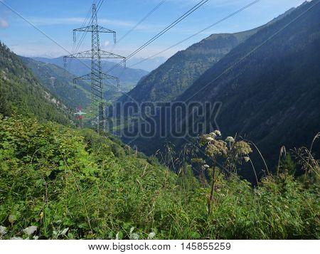 Electrical Wire Column In The Alpine Landscape