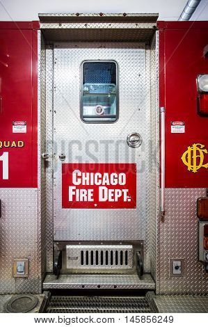 Chicago, USA - August 14, 2015: Chicago Metropolitan fire trucks sits inside a fire station in downtown Chicago