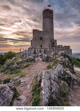 Ruins of medieval castle in Checiny over the sunset sky, Poland