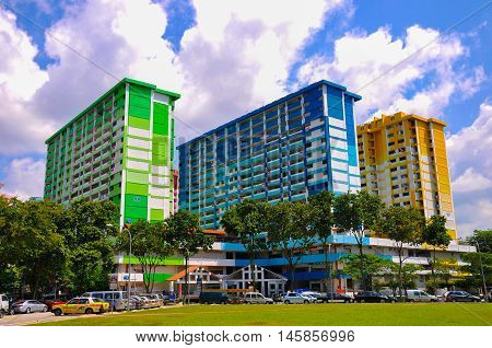 Bugis, Singapore - July 23, 2013: Three colorful apartment buildings in Rochor Centre in Bugis district situated in the middle of Singapore. It was built and completed in 1977 by the Housing and Development Board (HDB), Rochor Centre is a commercial and r