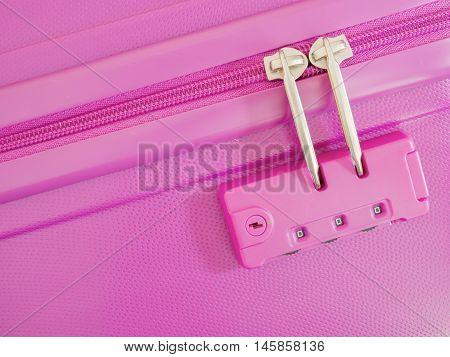 Closeup zipper lock password number on pink suitcase