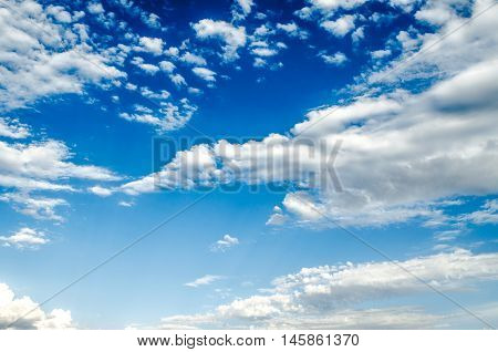 Highly cumulus clouds are gathering on sunny sky before the rain
