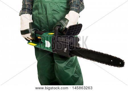 Gardener in uniform holding chainsaw