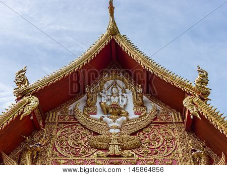 Golden gable with the angle sculpture of the Thai church.(Public area not required Property Release)