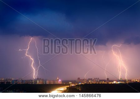 Lightning Strike Over City In Purple Light.