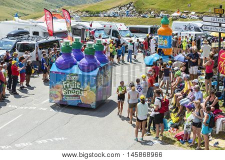 Col du Glandon France - July 23 2015: Teisseire caravan during the passing of the Publicity Caravan on Col du Glandon in Alps during the stage 18 of Le Tour de France 2015. Teisseire produces fruit juices and syrups for the food service industry.