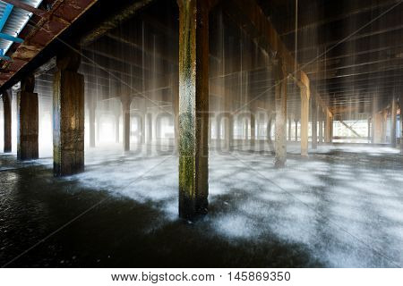 The water flows in the cooling tower at the plant.