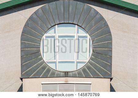 Modern circular windows in a building façade with zinc metal cover.